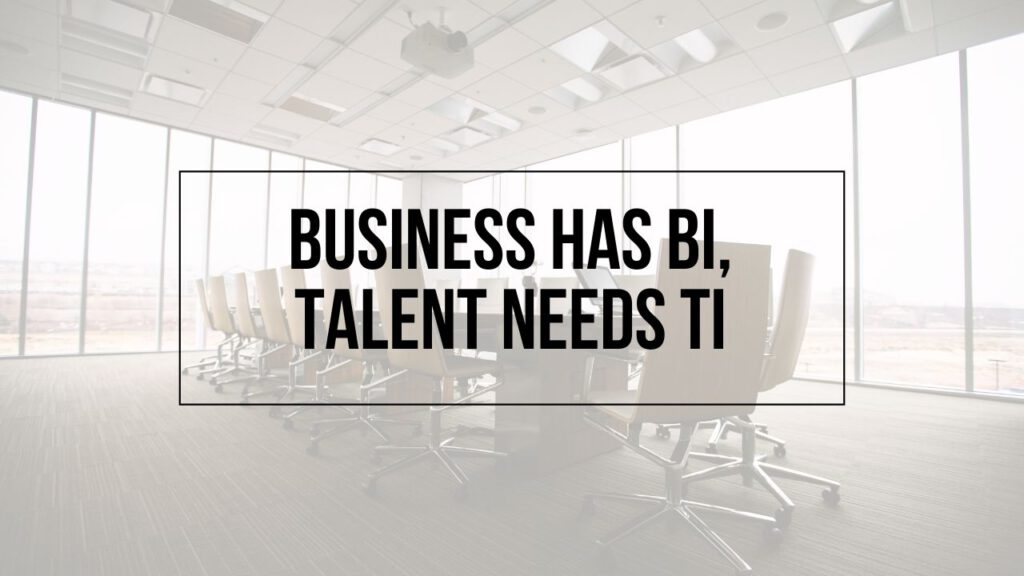 """Image of an office table with the text """"Business has BI, Talent has TI"""""""