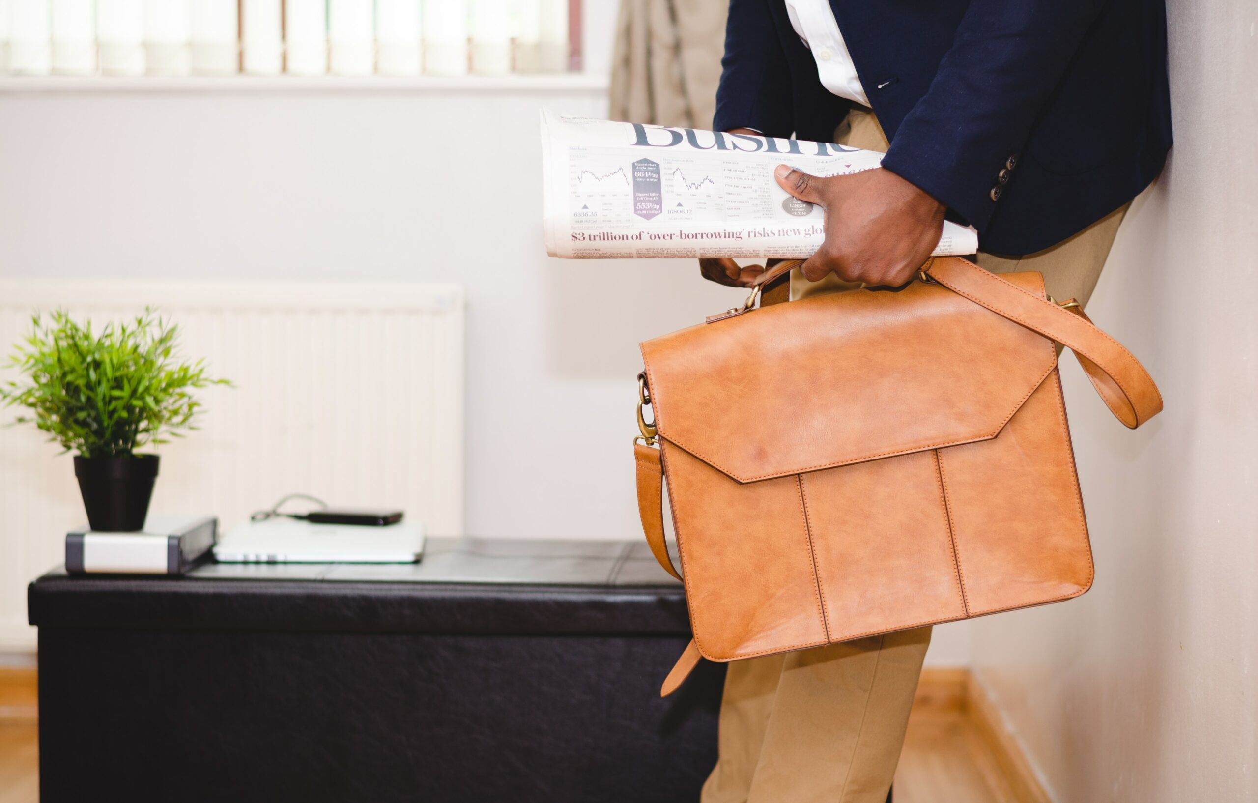 Image of a person holding a briefcase