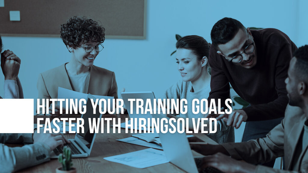 "Image of people working at a desk with text ""Hitting Your Training Goals Faster with HiringSolved"" on top"